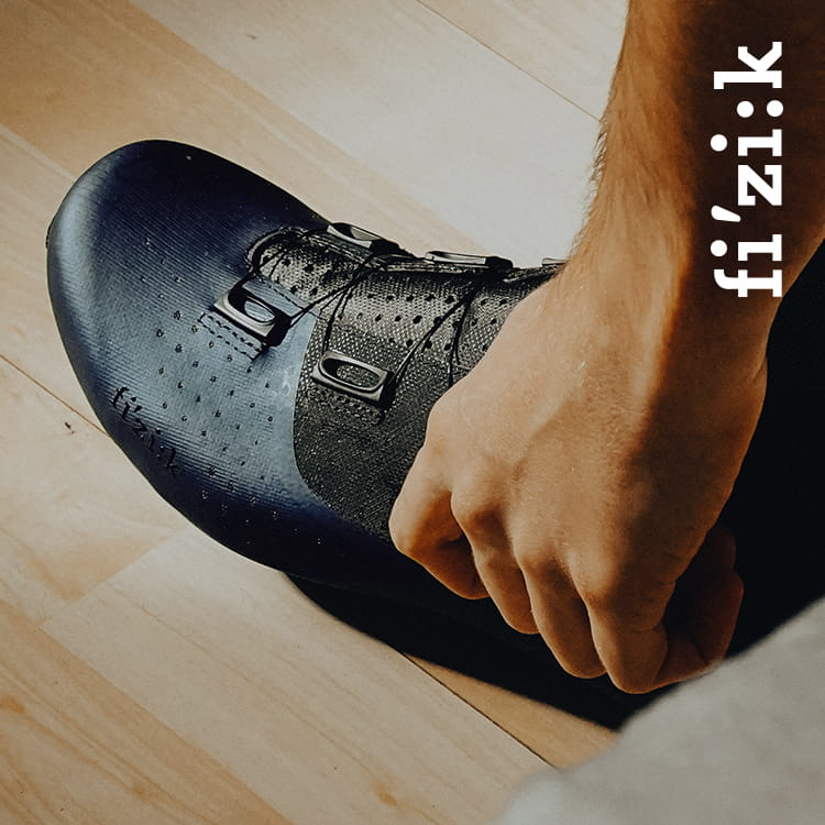 Close up of person putting on their Fizik cycling shoe