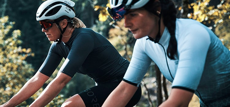 Two women out cycling wearing Gore Wear short sleeve jerseys