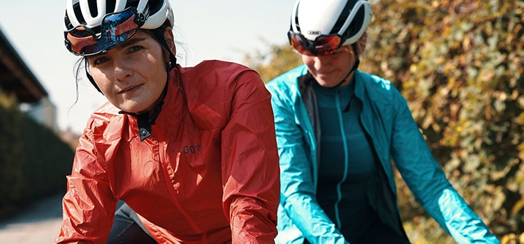 Two women out cycling wearing Gore Wear cycle jackets