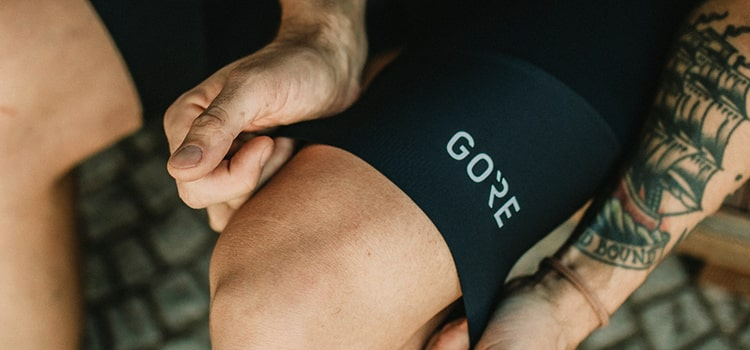 Man wearing black Gore Wear bib shorts