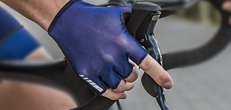 Person wearing blue GripGrab gloves