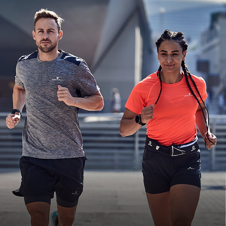 Guy and girl out running wearing Ronhill running tops and shorts