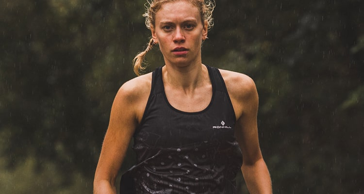 Girl out running wearing a sustainable black patterned ronhilll run vest