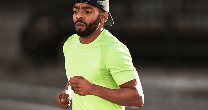 Guy out running wearing Under Armour run clothing