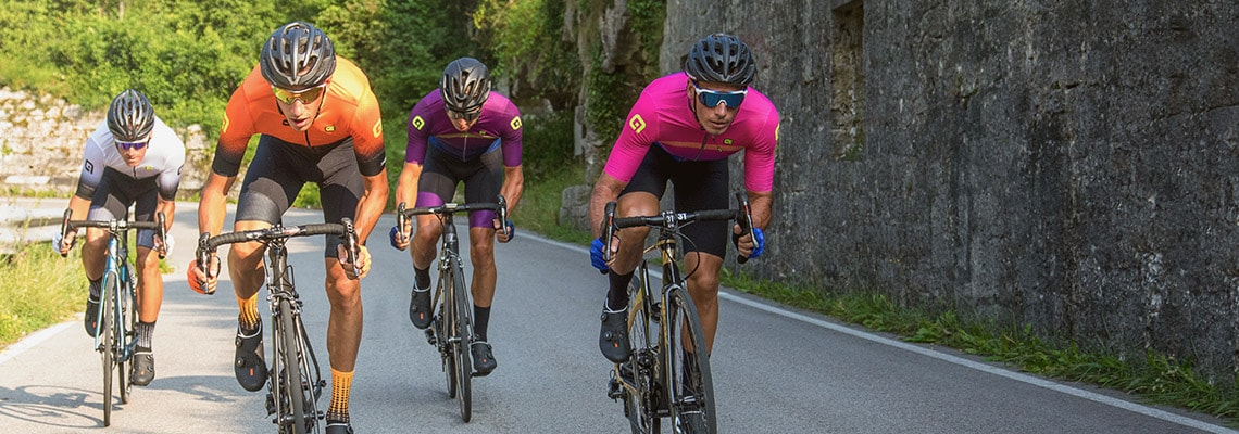 A group of road cyclists riding downhill, wearing the new Alé spring/summer 2019 kit. Click to shop this seasons Alé cycling range.