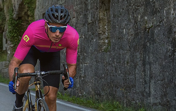 A Road cyclists is riding downhill, wearing the new Alé spring/summer 2019 kit. Click to shop this seasons Alé cycling range.