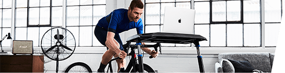 A cyclist on a turbo trainer using VirtuGO. The first indoor training platform with Professional Cycling DNA. Find out more with wiggle.